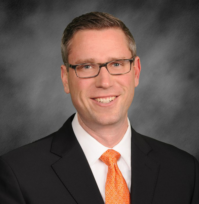 Posed smiling photo of Illinois State Treasurer Michael Frerichs